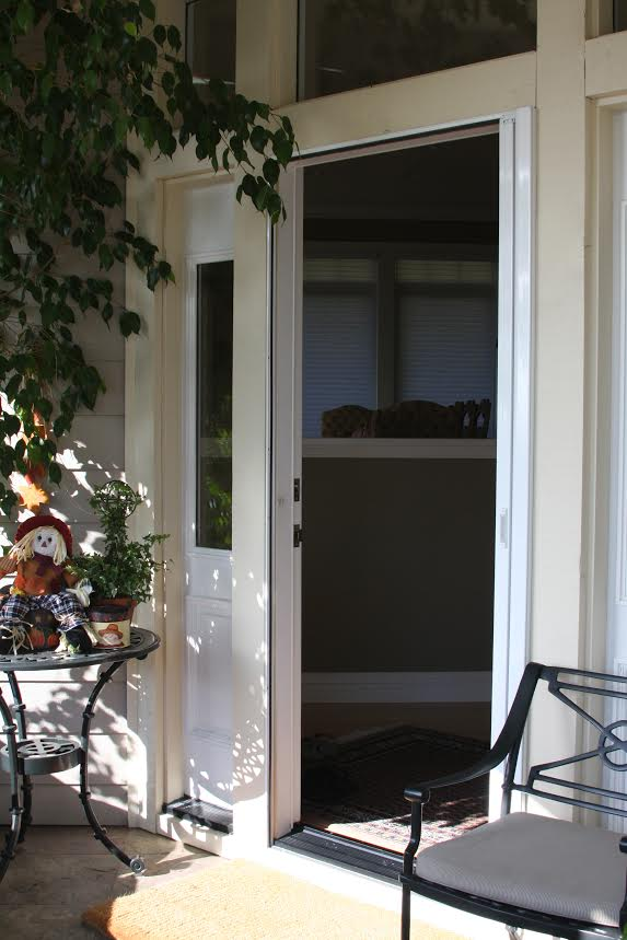 Roll-Away® retractable screen door single (open)